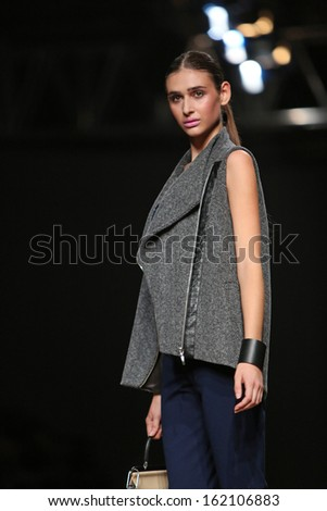 ZAGREB, CROATIA - OCTOBER 23: Fashion model wearing clothes designed by Nebo on the Cro a Porter show on October 23, 2013 in Zagreb, Croatia.
