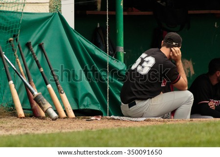 ZAGREB, CROATIA - OCTOBER 03, 2015: Match between Baseball Club Zagreb and Medvednica. Baseball player is resting - stock photo