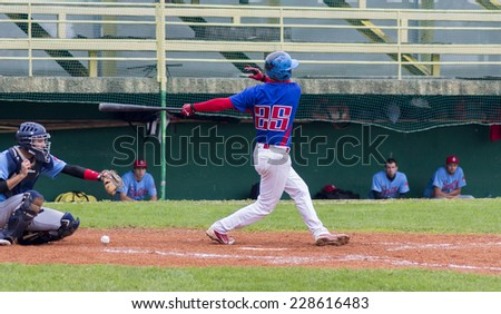 ZAGREB. CROATIA - OCTOBER 04, 2014: Match between Baseball Club Zagreb in dark blue jersey and Split in light blue jersey. Unidentified batter miss the ball
