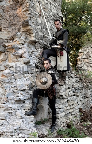 "ZAGREB, CROATIA - OCTOBER 07, 2012: Woman and a man dressed in medieval clothes with swords, posing after the ""Knights Tournament"" revival"
