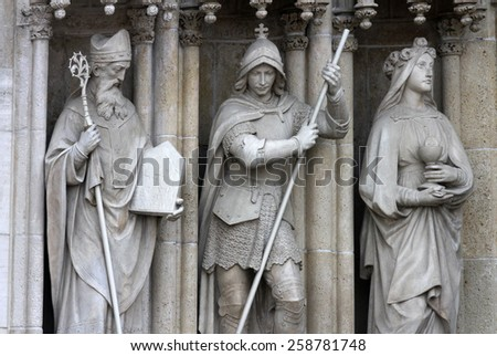 ZAGREB, CROATIA - SEP 25: Saints Methodius, George, Barbara on the portal of the cathedral dedicated to the Assumption of Mary and to kings Saint Stephen and Saint Ladislaus in Zagreb on Sep 25, 2013. - stock photo