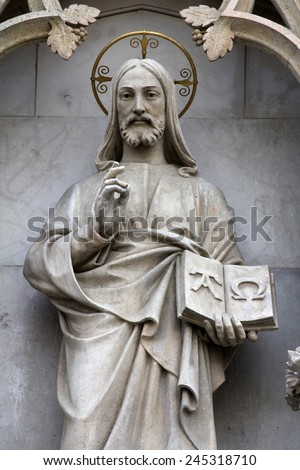 ZAGREB, CROATIA - SEPT 26: statue of Christ the Teacher on the portal of the cathedral dedicated to the Assumption of Mary and to kings Saint Stephen and Saint Ladislaus in Zagreb on Sept 26, 2013. - stock photo