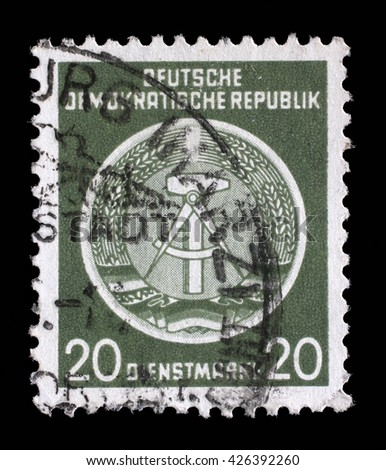 ZAGREB, CROATIA - SEPTEMBER 18: A Stamp printed in GDR (German Democratic Republic - East Germany) shows DDR national coat of arms, circa 1952, on September 05, 2014, Zagreb, Croatia - stock photo