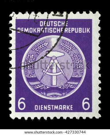 ZAGREB, CROATIA - SEPTEMBER 05: A Stamp printed in GDR (German Democratic Republic - East Germany) shows DDR national coat of arms, circa 1952, on September 05, 2014, Zagreb, Croatia - stock photo