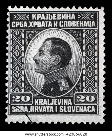 ZAGREB, CROATIA - SEPTEMBER 13: A stamp printed in Yugoslavia (Kingdom Serbia, Croatia and Slovenia) shows King Alexander I of Yugoslavia, circa 1924, on September 13, 2014, Zagreb, Croatia - stock photo