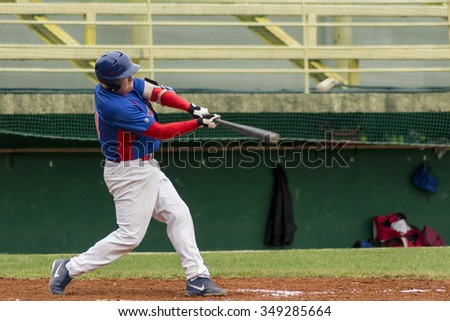 ZAGREB, CROATIA - SEPTEMBER 27, 2015: Match between Baseball Club Zagreb and Club Medvednica. Hitter hits the ball - stock photo