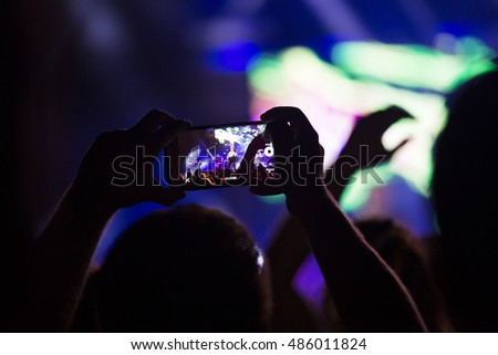 ZAGREB, CROATIA - SEPTEMBER 17, 2016: Opca opasnost rock band concert on Salata stadium in Zagreb - fans video recording concert with cell phone