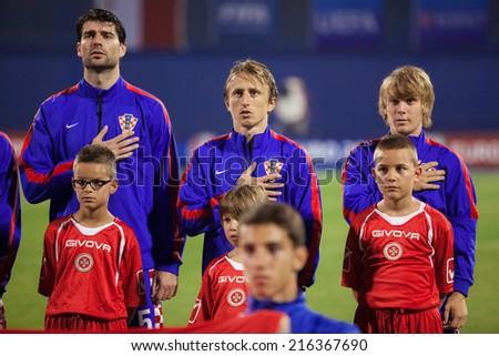 ZAGREB, CROATIA - SEPTEMBER 9, 2014: UEFA European Championship 2016 qualifiers in Group H - Croatia VS Malta. Vedran CORLUKA (5), Luka MODRIC (10) and Alen HALILOVIC (8) during national anthem. - stock photo