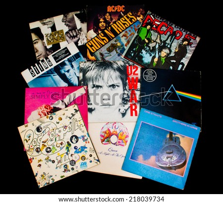 ZAGREB , CROATIA - SEPTEMBER 17 , 2014 -  various old vinyl LP records on black background, product shot - stock photo