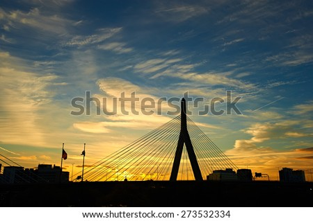 Zakim Bunker Hill Memorial Bridge at sunset in Boston, Massachusetts - stock photo