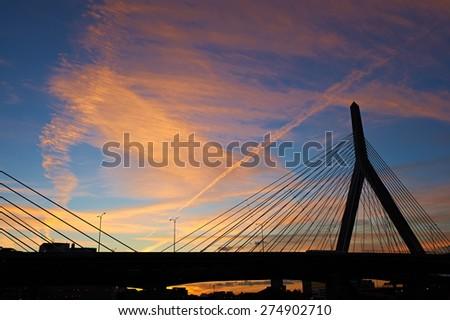 Zakim Bunker Hill Memorial Bridge at sunset in Boston, Massachusetts - stock photo