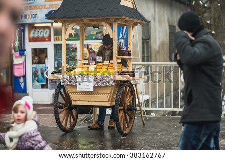ZAKOPANE, POLAND - FEBRUARY 13, 2016: Famous Krupowki street in Zakopane at witer time. Krupowki street is the main shopping area and pedestrian promenade in the center of Zakopane, Poland.