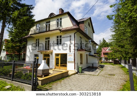 ZAKOPANE, POLAND - JUNE 10, 2015: Holiday Resort namend Bialy Slad (White Trail) offers 16 guestrooms, a total of 45 beds for guests coming to town for a holiday stay - stock photo