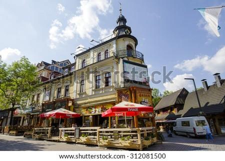 ZAKOPANE, POLAND - JUNE 12, 2015: Leisten House, brick house built in 1900 by Samuel Leisten as a hotel in the city center in Zakopane in Poland on November 15, 2013 - stock photo