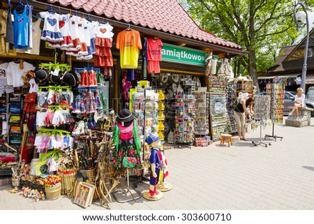 ZAKOPANE, POLAND - JUNE 07, 2015: Various souvenirs offered for sale, the stands located along the famous pedestrian street, among other offers stylized gifts and many small stuff - stock photo