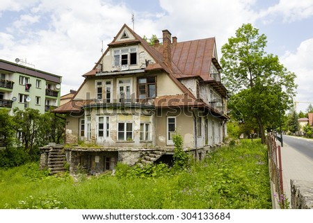 ZAKOPANE, POLAND - JUNE 14, 2015: Villa called Maryska, built of wood probably at the turn of the 19th and 20th century, nowadays greatly devastated building - stock photo