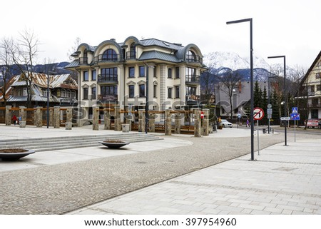 ZAKOPANE, POLAND - MARCH 06, 2016: A modern apartment block built on the site of a former printing house - Polonia, on the ground floor of the building operates fine-dining restaurant since July 2014