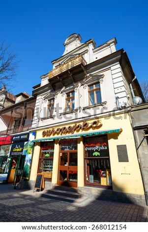ZAKOPANE, POLAND - MARCH 09, 2015: Famous Cafe named Europejska, in the place of the former bookstore previously owned by bookseller and publisher Leonard Zwolinski, located in townhouse built in 1900 - stock photo