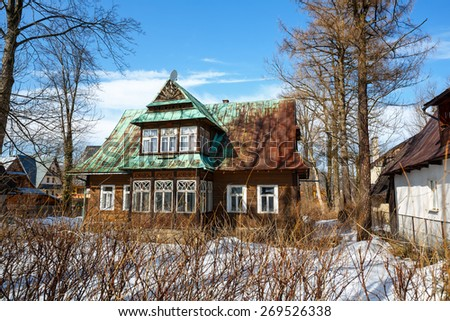 ZAKOPANE, POLAND - MARCH 10, 2015: Made of wood Villa Marya, built in 1902, located at Witkiewicza street, listed in the municipal register of architectural heritage  - stock photo