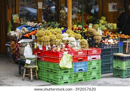 ZAKOPANE, POLAND - MARCH 07, 2016: Nuts, beans and other vegetables and fruits offered for sale at a street market stall placed in front of the store site at the local market - stock photo