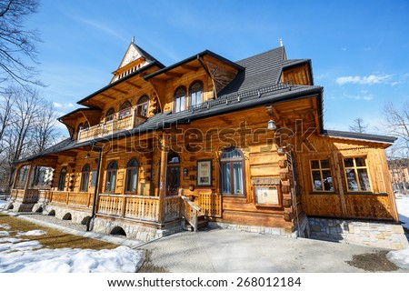 ZAKOPANE, POLAND - MARCH 10, 2015: Villa Jutrzenka built in the style of Zakopane in 1900, nowadays the seat of Tatra Culture and Sport Center, Gallery Art-Park and Art Museum  - stock photo