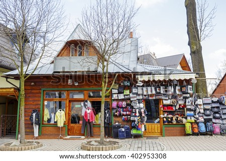 ZAKOPANE, POLAND - MARCH 09, 2016: Wooden building inside which you can see clothing store. Facade is used for the front shop purposes. It is located at Krupowki, the main shopping street in the city
