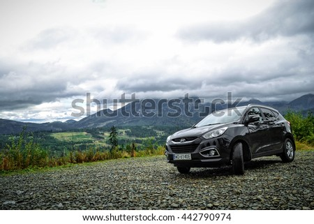 ZAKOPANE, POLAND - SEPTEMBER 23, 2013: Hyundai ix35 parked on a track in Polish mountains.