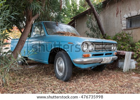 Zakynthos, Greece - August 16, 2016: closeup view of old blue Datsun 1300 pickup car