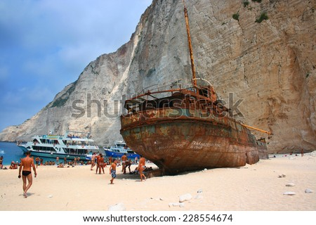 Zakynthos, Greece - August 30: Navagio Beach in Zakynthos island, Greece on August 30, 2009. Amazing Navagio Beach and close up view of Shipwreck, popular attraction among tourists - stock photo