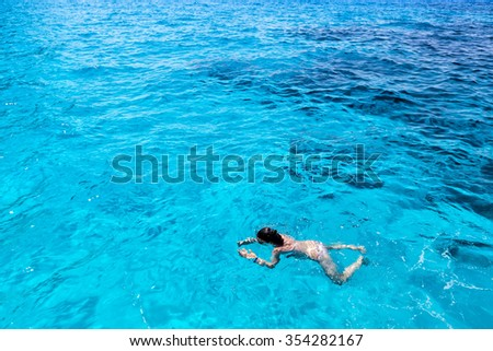 Zakynthos, Greece - August 11, 2015: Tourists enjoying the clear water of Zakynthos island, in Greece. Navagio Beach is a popular attraction among tourists visiting the island of Zakynthos