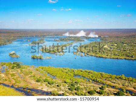 Zambezi river and Victoria Falls, bird's-eye view - stock photo