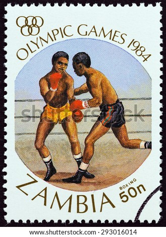 """ZAMBIA - CIRCA 1984: A stamp printed in Zambia from the """"Olympic Games, Los Angeles """" issue shows Boxing, circa 1984. - stock photo"""