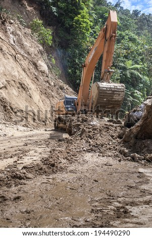ZAMORA,ZAMORA CHINCHIPE, ECUADOR Circa May 2014. Landslide on mountain road in the Andes, Zamora, Zamora Chinchipe Circa May 2014. Rains have caused mudslide on roads in Andes Mountains of Ecuador - stock photo