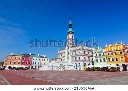 Zamosc, Poland. Historic buildings with the town hall in the Great Market. Panorama view. - stock photo