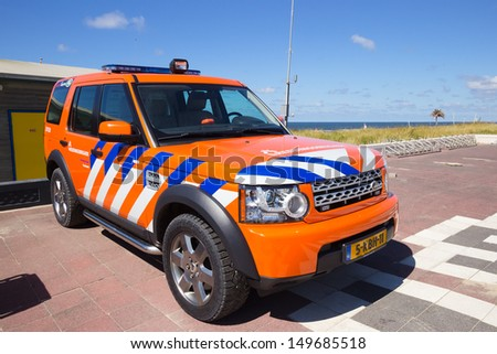 ZANDVOORT, HOLLAND - AUG 8: Dutch lifeguard Land Rover Discovery on standby at the Beach on Aug 8, 2013 in Zandvoort, The Netherlands. Two cars were delivered to the Zandvoort lifeguard in 2007. - stock photo
