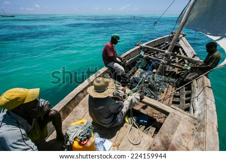 ZANZIBAR - OCTOBER 29, 2008: Unidentified local fisherman go for fishing on a traditional boat called Dhow in Zanzibar on 29 October, 2008   - stock photo