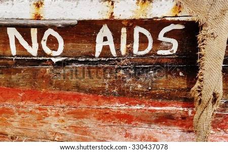 ZANZIBAR, TANZANIA -18 JUNE 2015- Sign in the street in Zanzibar, Tanzania, warning against the spread of HIV by saying NO AIDS HERE.