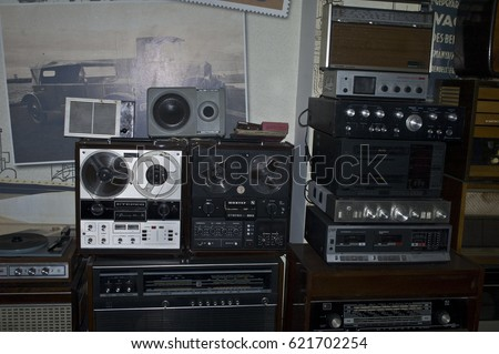ZAPORIZHIA, UKRAINE - DECEMBER 8, 2016: The exhibition of vintage tv-receivers, old audio players and receiving-sets and radio in the museum of vintage technology