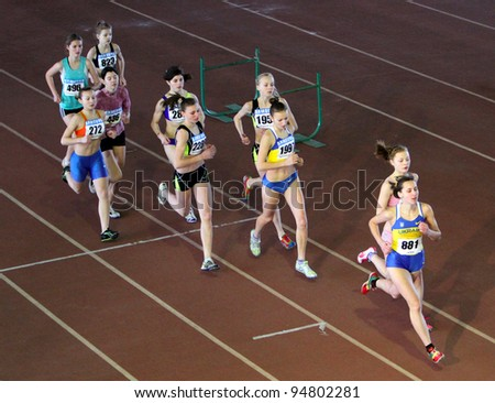 ZAPORIZHIA,UKRAINE-JAN 31:(L-R)Lucik Nadia, Pats Aleksandra, Melnik Ana, Chernikova Ana run the 3,000 m. race at the Ukrainian Junior Track & Field Championships on January 31, 2012 in Zaporizhia, Ukraine - stock photo