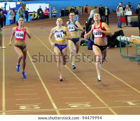 ZAPORIZHIA, UKRAINE - JAN.28:(L-R) Zemlak Olga, Olishevska Ulia, Muravieva Irina and Elizaveta Bryzgina on 400 m. race on the Ukrainian Cup in Athletics, on January 28, 2012 in Zaporizhia, Ukraine. - stock photo