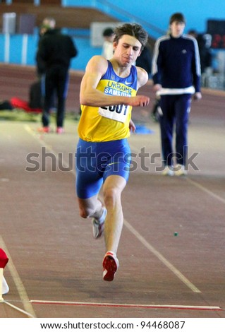 ZAPORIZHIA, UKRAINE - JAN. 27 : Vlasov Mihailo wins the triple jump with the result 16.20 on the Ukrainian Cup in Athletics, on January 27, 2012 in Zaporizhia, Ukraine.