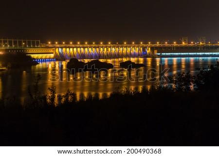 Zaporozhye hydro power plant on the river Dnepr at night. Ukraine - stock photo