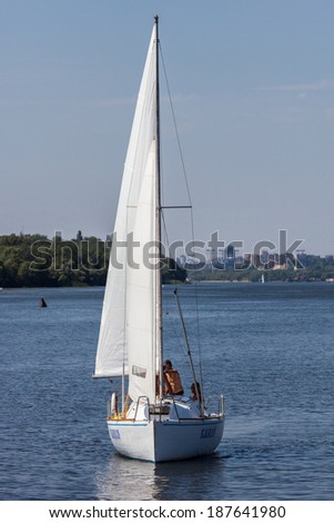 ZAPOROZHYE, UKRAINE-AUGUST 11: Sailing yacht 11, 2012 in Zaporozhye, Ukraine. Sailing yacht on the Dnieper River on the background of the island Khortytsya near the city Zaporozhye.