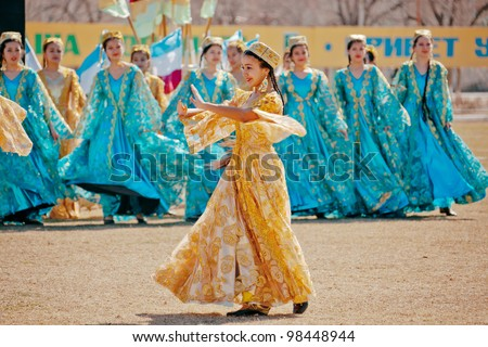 ZARAFSHAN, UZBEKISTAN - MARCH 21: Unidentified children dance and sing in celebration of the Navroz, spring Festival. March 21, 2012 in Zarafshan, Uzbekistan. - stock photo