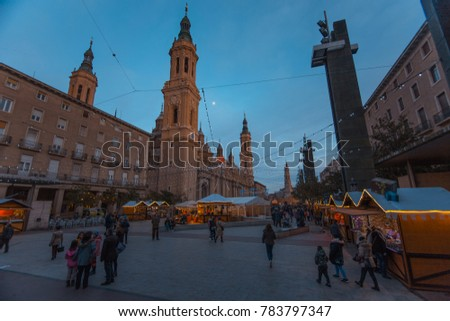 Zaragoza, Spain - December 29, 2017: people walking on Christmas market in Plaza del Pilar in Zaragoza. Spain.