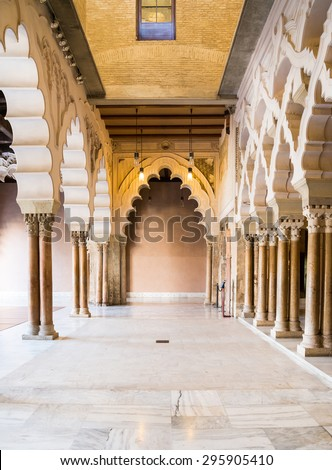 ZARAGOZA, SPAIN, JUNE 9, 2014:  Arches and rooms of the Nord Porch within the Aljaferia Palace at Zaragoza, Spain
