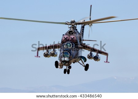 ZARAGOZA, SPAIN - MAY 20,2016: Special painted Czech Republic Air Force Mil Mi-24 Hind attack helicopter coming in for Landing at Zaragoza airbase. - stock photo