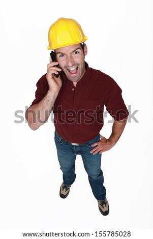 Zealous man on the phone - stock photo
