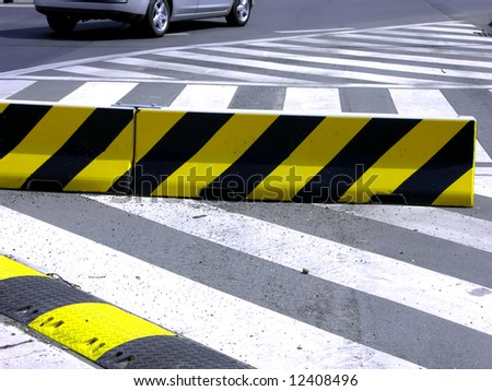 zebra-crossing and speed-bump on the street - stock photo