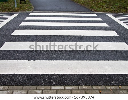 Zebra crossing on a speed bump - stock photo